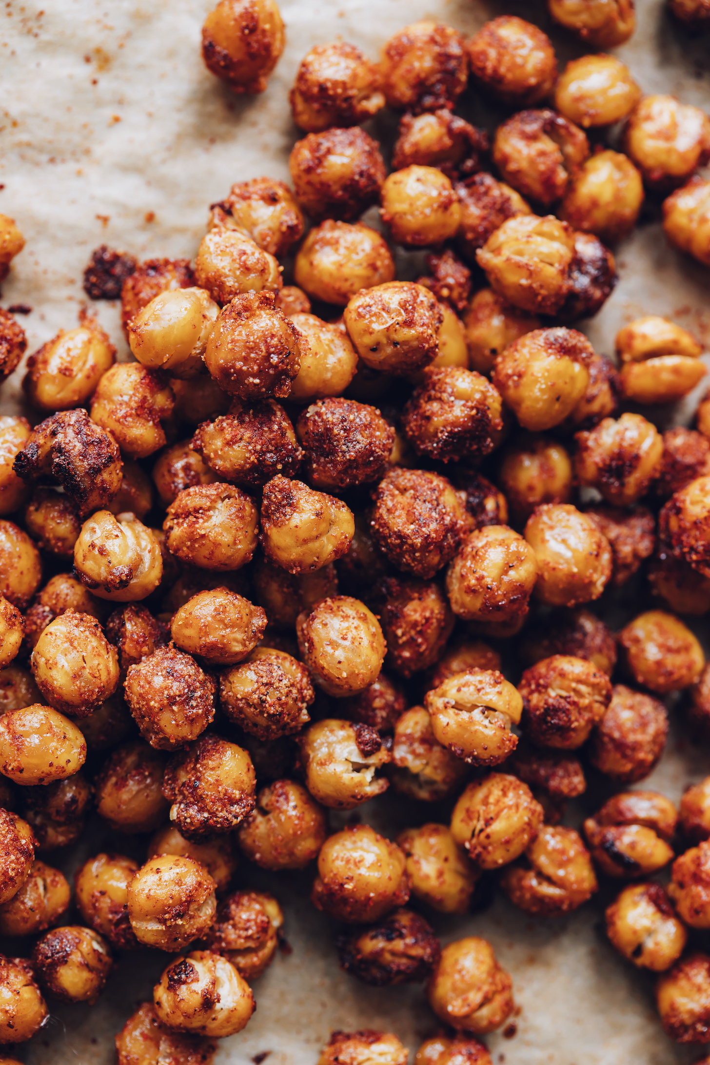 BBQ roasted chickpeas on a parchment-lined baking sheet