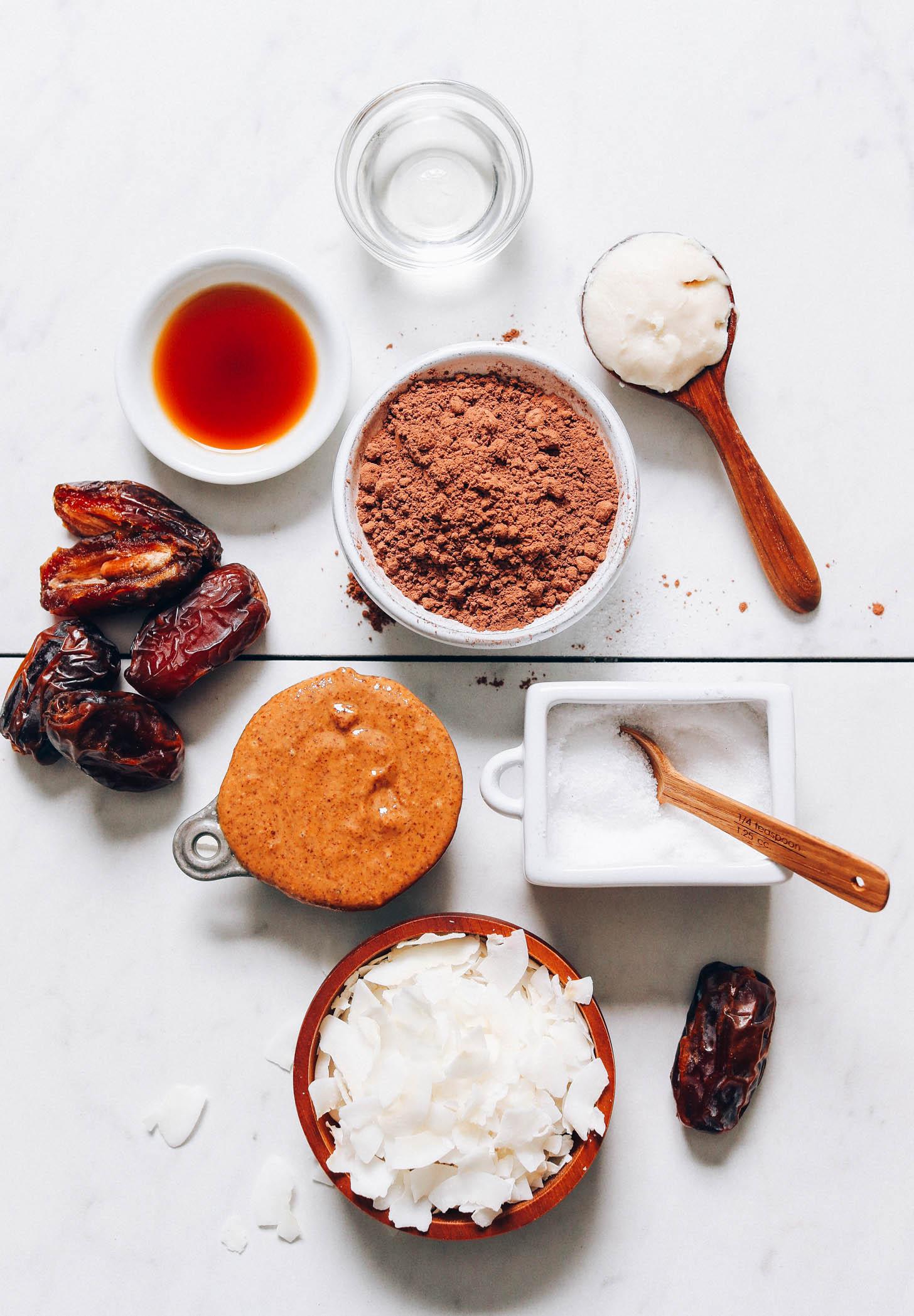 Dates, almond butter, coconut, salt, cacao powder, coconut butter, and coconut oil