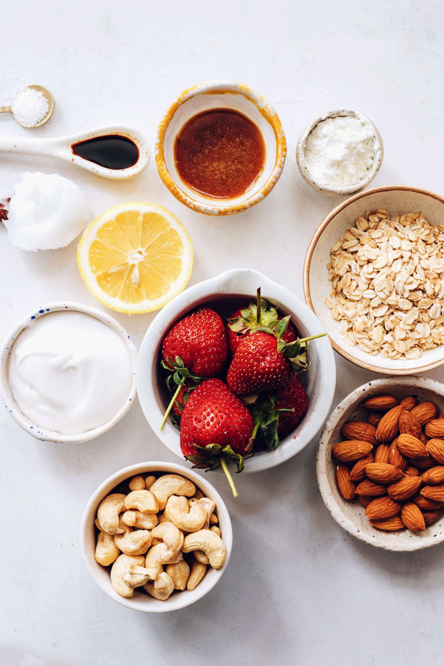 Cashews, almonds, oats, strawberries, coconut cream, lemon, cornstarch, maple syrup, vanilla, coconut oil, and salt