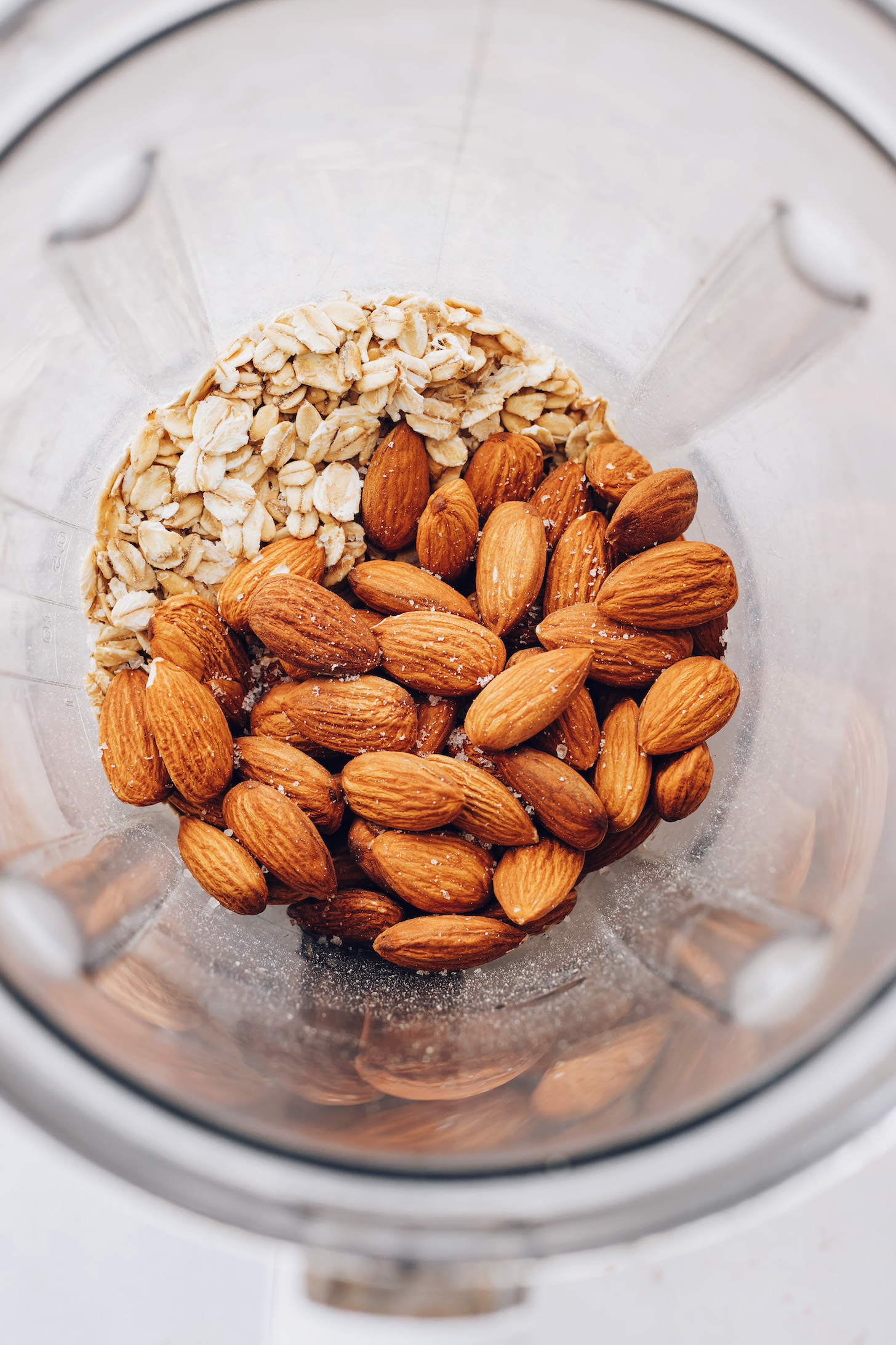Oats, almonds, and sea salt in a blender