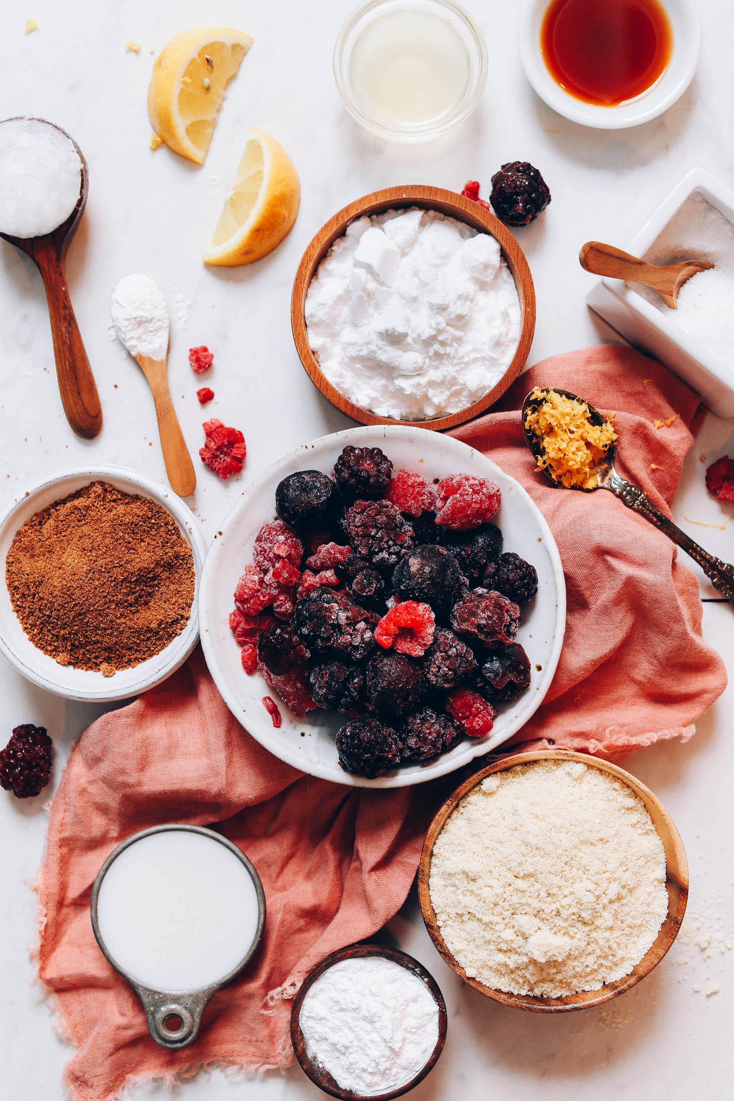 Frozen berries, coconut sugar, arrowroot powder, lemon zest, coconut milk, vanilla, apple cider vinegar, potato starch, almond flour, salt, and coconut oil