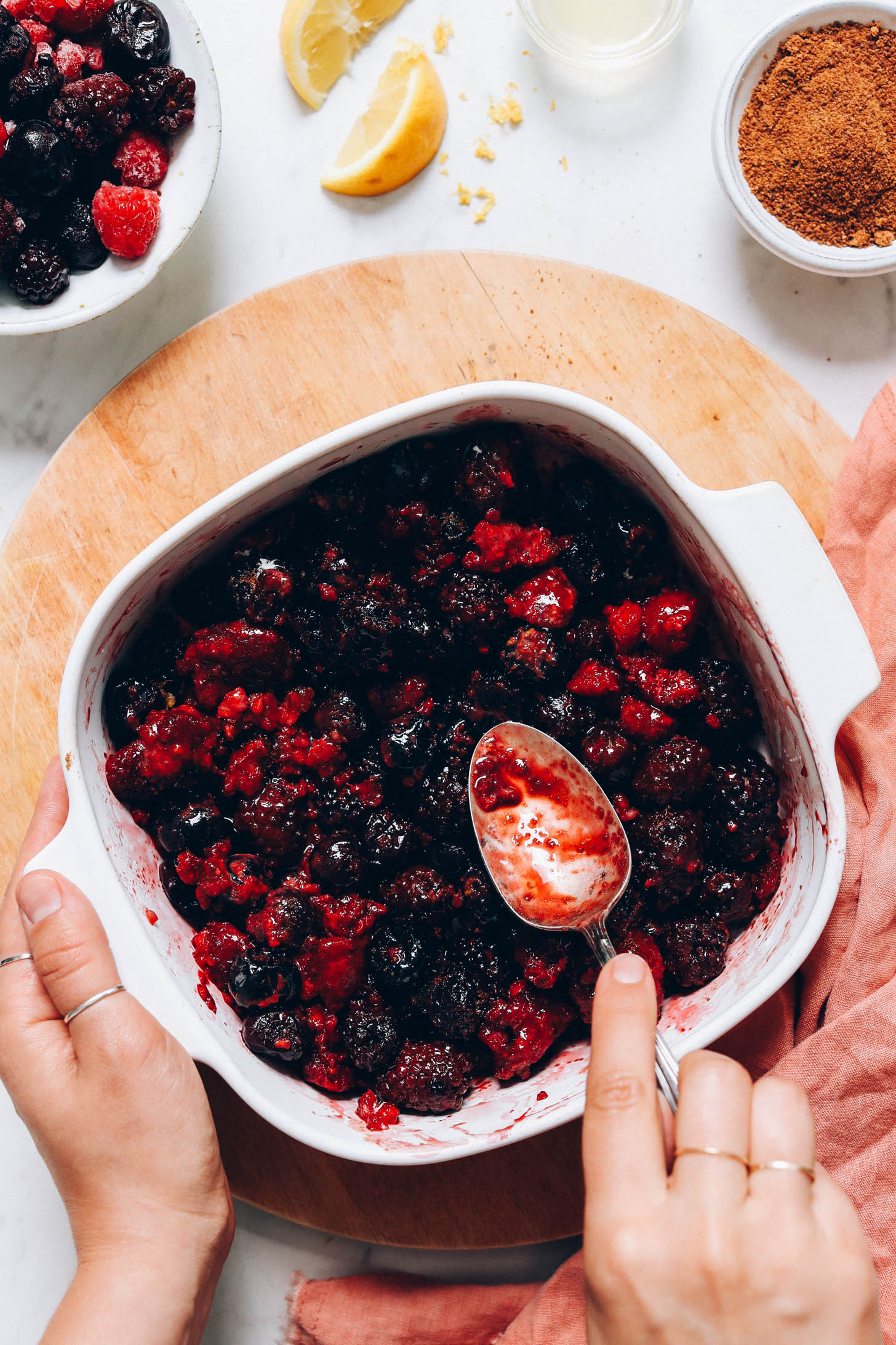 Spoon in a baking dish of mixed berries