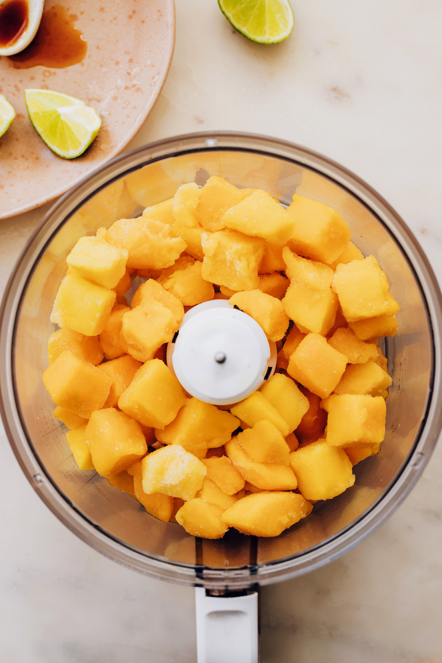 Frozen mango chunks in a food processor
