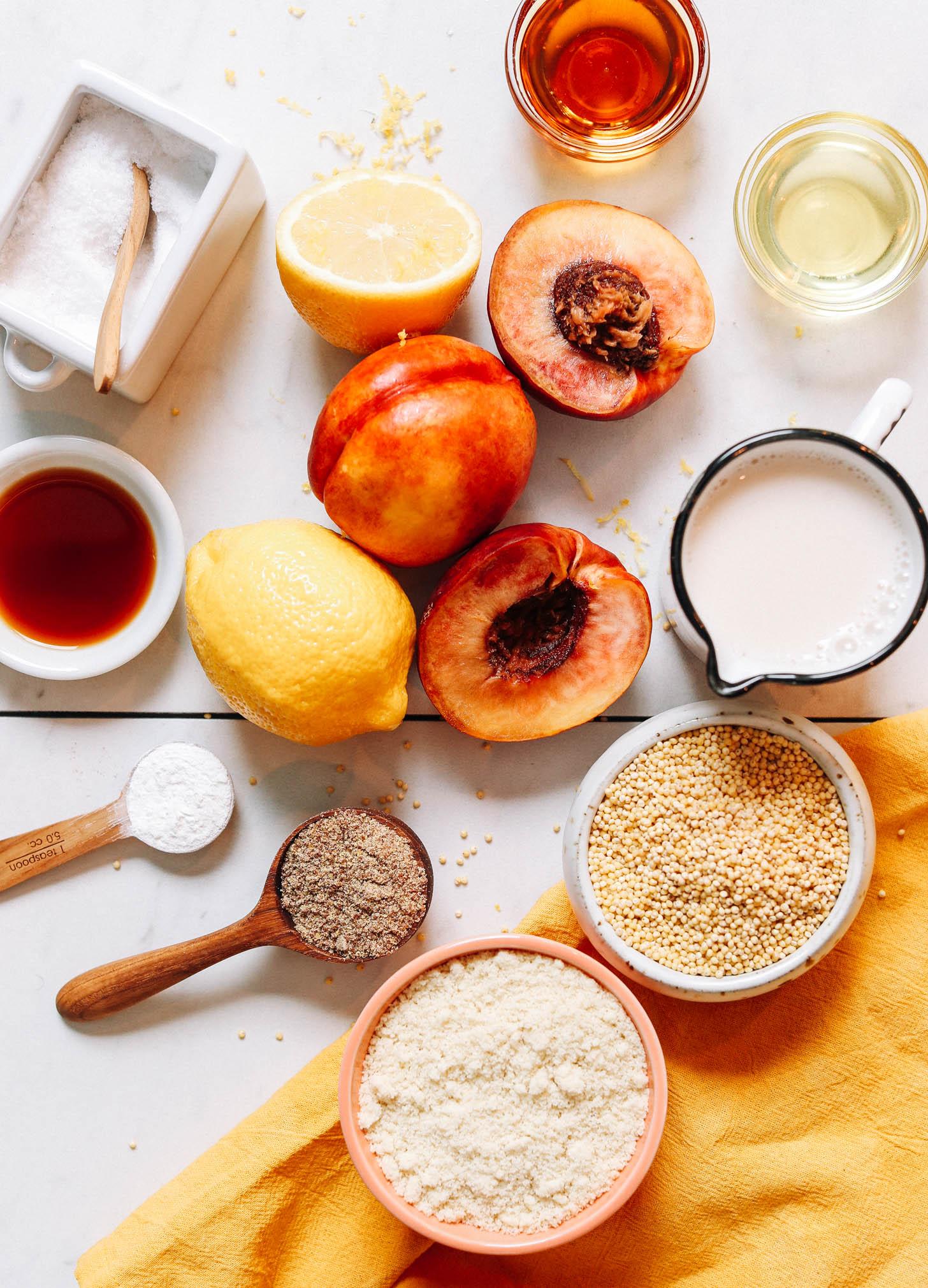 Salt, nectarines, lemon, maple syrup, vanilla, flaxseed, baking powder, almond flour, millet, almond milk, and avocado oil