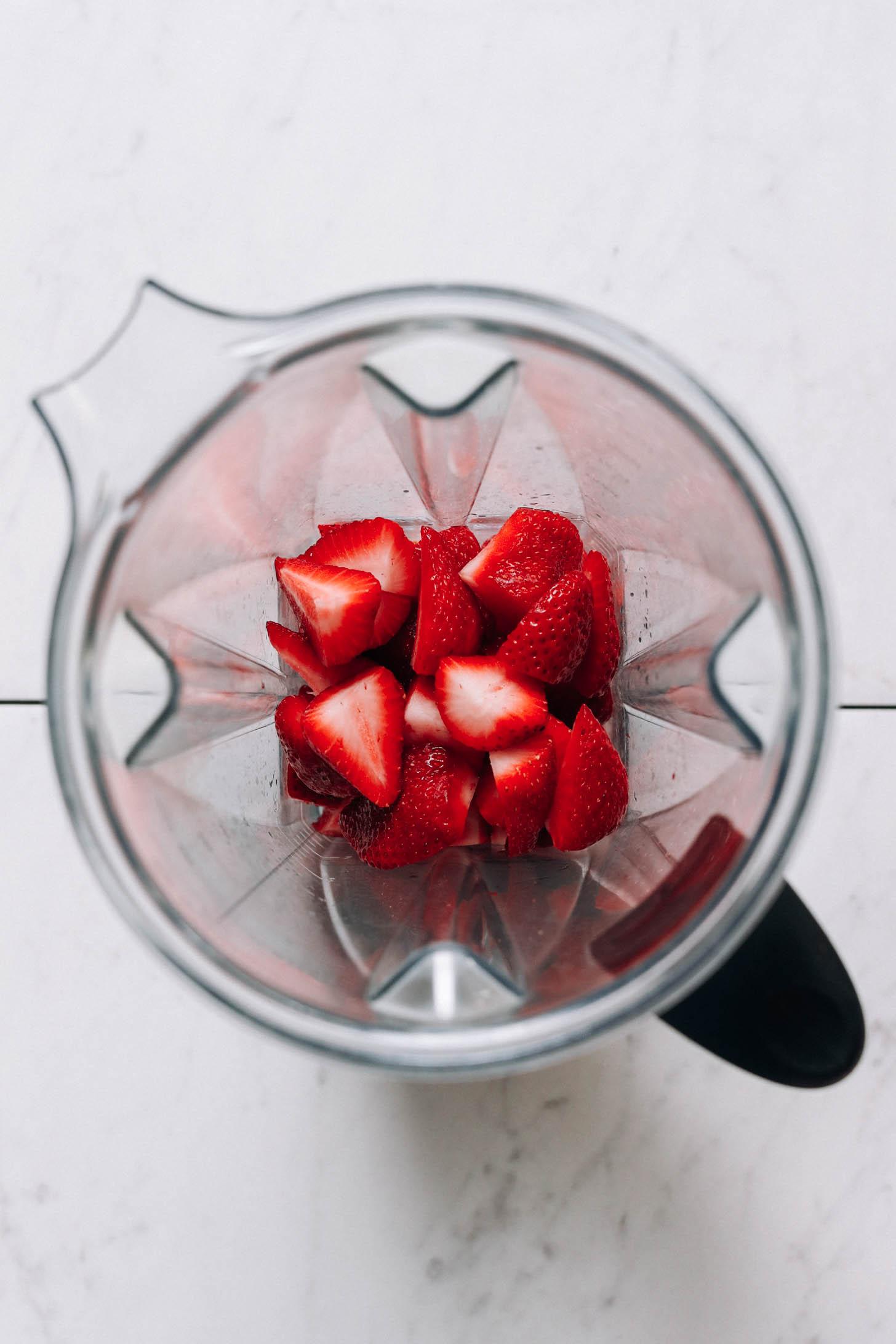 Blender with fresh strawberries