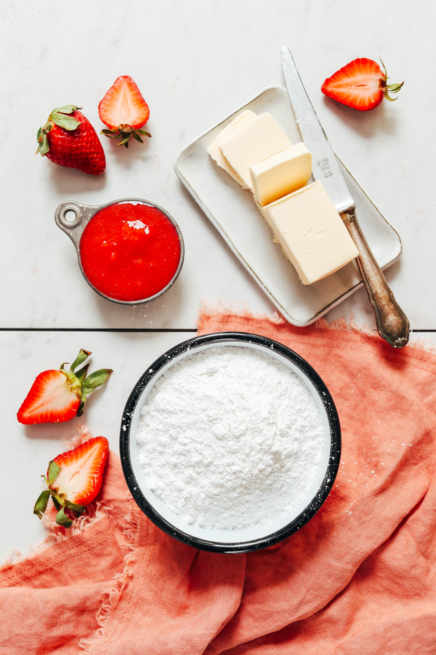 Fresh strawberries, powdered sugar, vegan butter, and strawberry compote