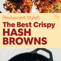 A cast-iron pan with crispy hash browns in it with ketchup
