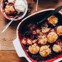 Bowl and pan of gluten free berry cobbler