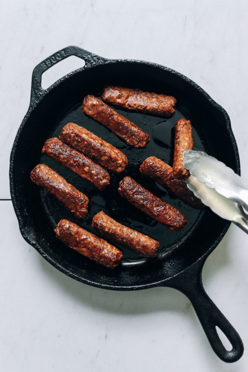 Cooking vegan sausage links in a cast iron skillet