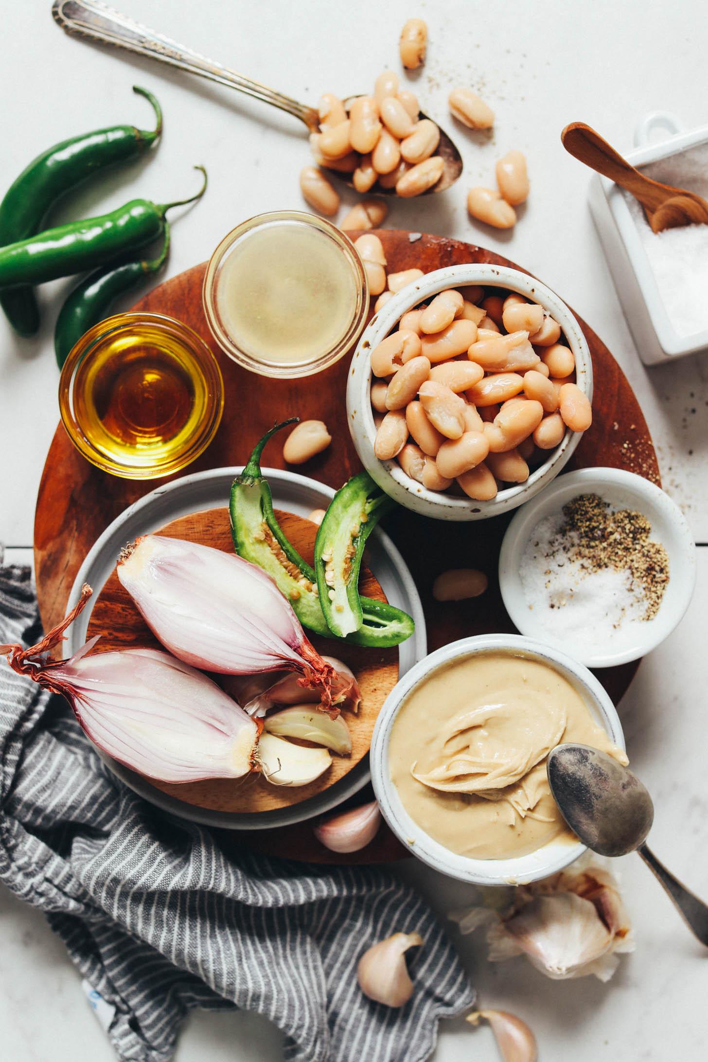 Serrano peppers, white beans, lemon, olive oil, shallot, garlic, cashew butter, salt, and pepper