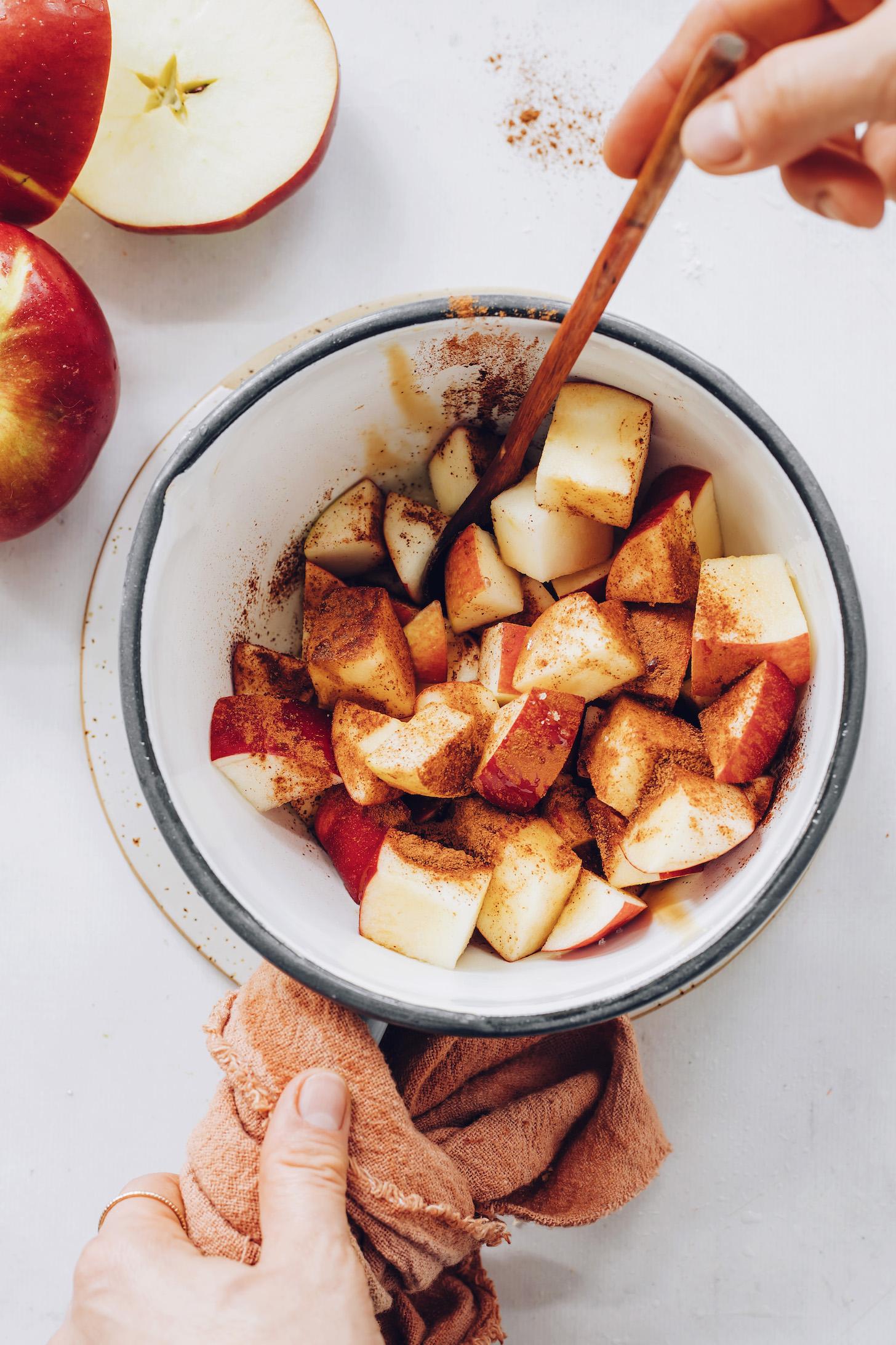 Saucepan of chopped apples with cinnamon
