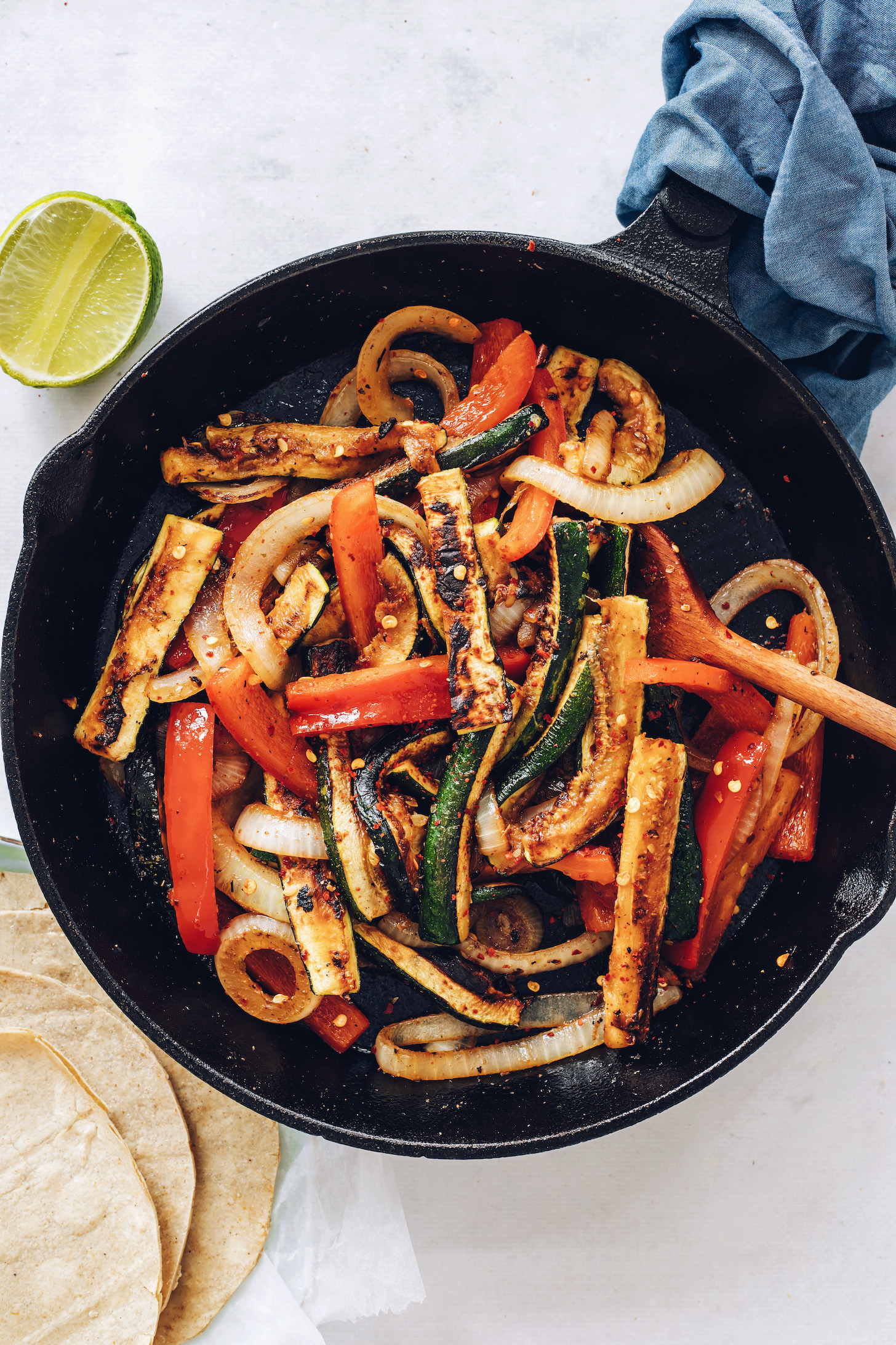 Skillet of sautéed onions, bell pepper, and zucchini with spices