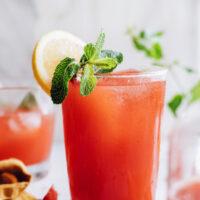 Glasses of homemade strawberry lemonade topped with fresh mint