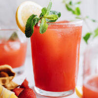 Glass of homemade strawberry lemon with a lemon slice on the rim
