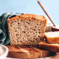 Partially sliced loaf of homemade gluten-free bread