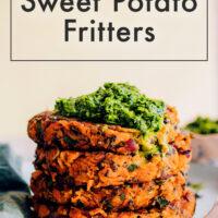 Stack of vegan and gluten-free kale and sweet potato fritters with mint chutney on top