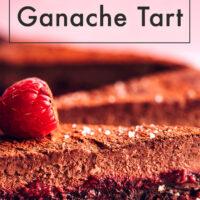 Slices of vegan and gluten-free raspberry chocolate ganache tart with a raspberry on top