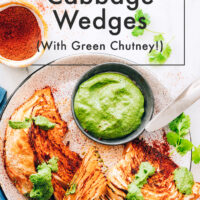 Plate of vegan and gluten-free shawarma roasted cabbage wedges with green chutney