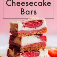 Stack of vegan and gluten-free strawberry cheesecake bars