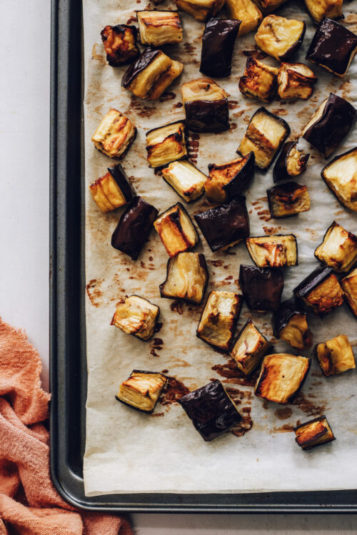 Baking sheet of perfectly tender oven roasted eggplant cubes