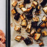 Cubed roasted eggplant on a baking sheet