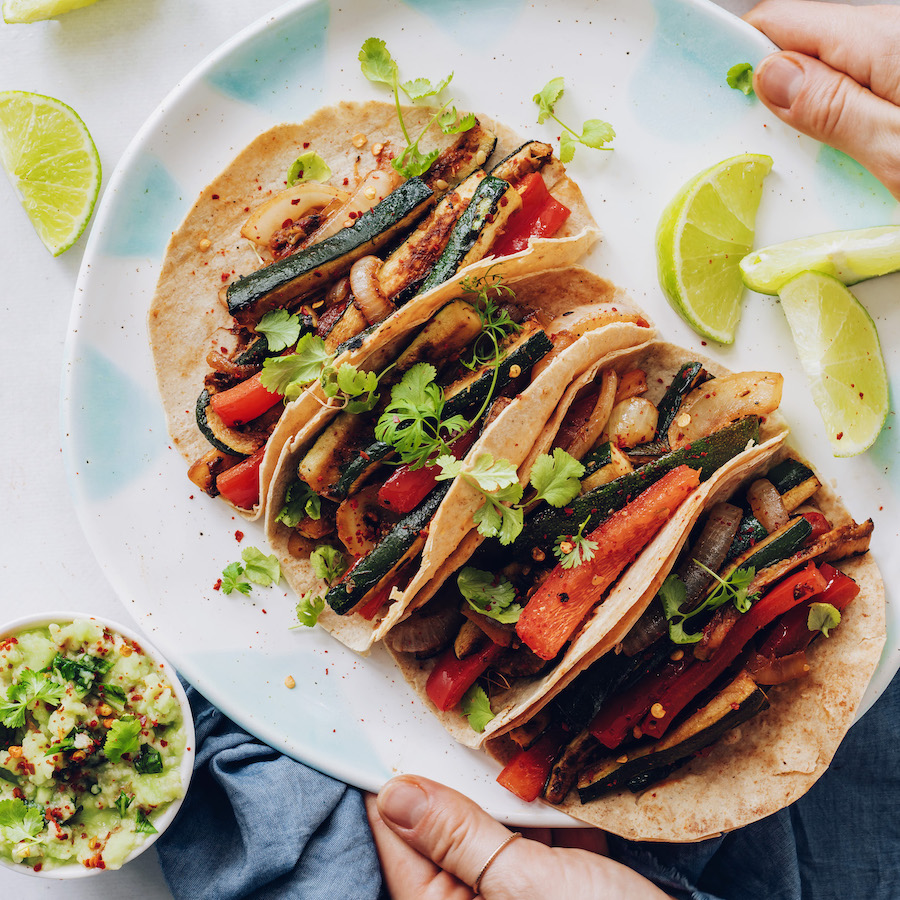 Platter of easy vegan tacos made with zucchini and bell pepper