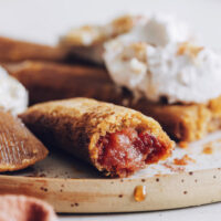 Apple butter dessert tamales topped with coconut whipped cream
