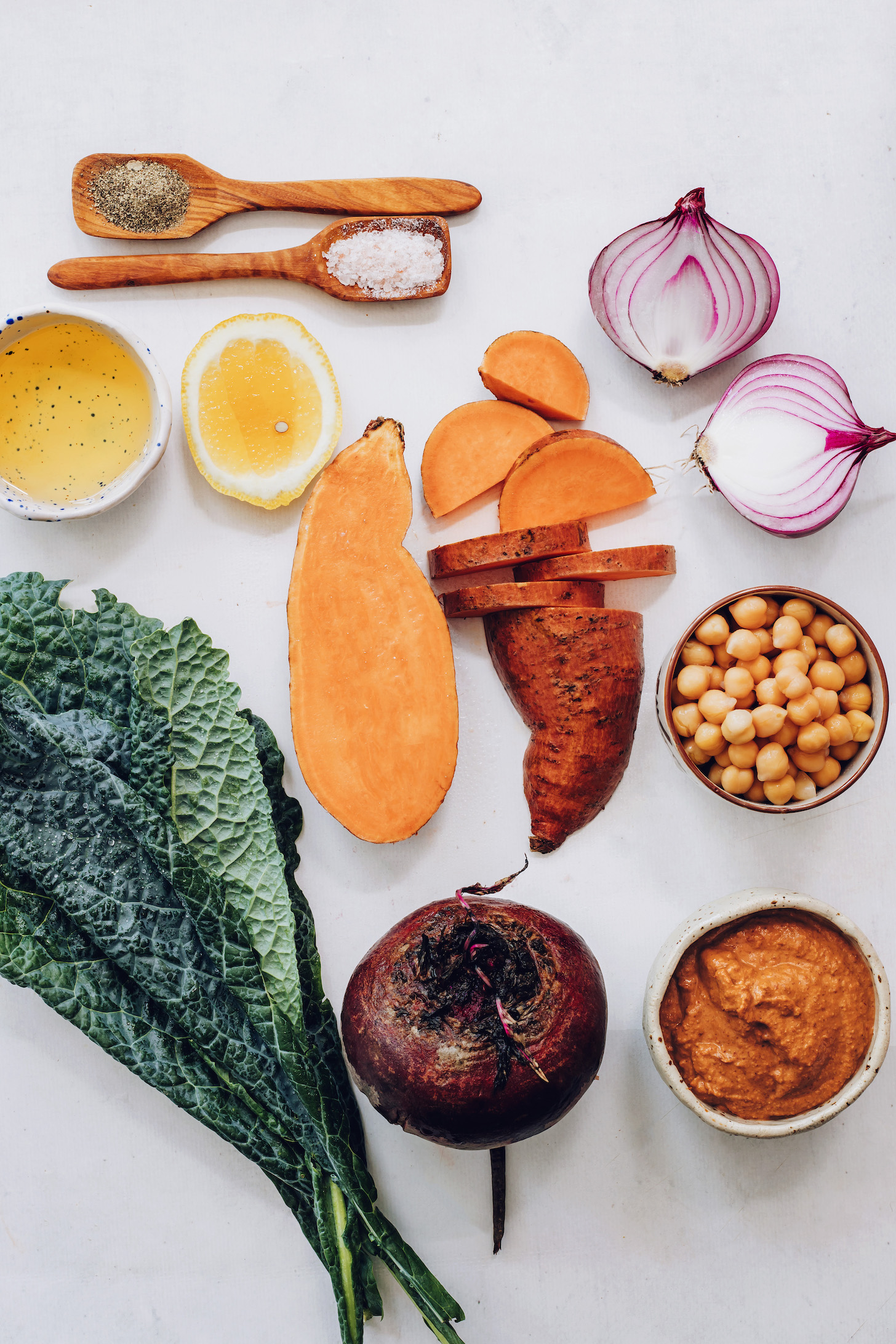 Kale, beet, sweet potato, chickpeas, chipotle pecan pesto, red onion, lemon, salt, and olive oil