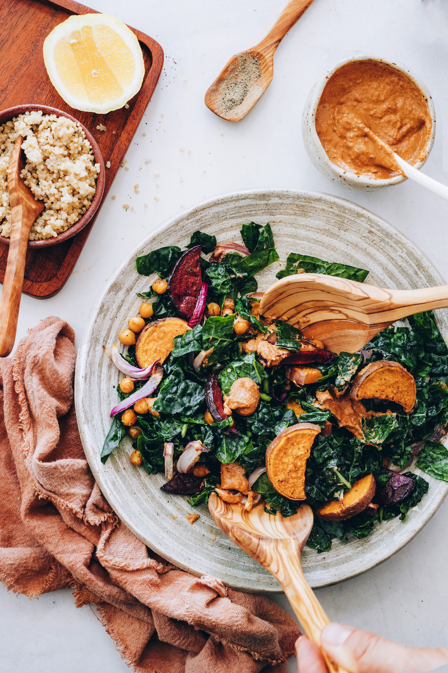 Bowl of kale with roasted vegetables and chipotle pecan pesto