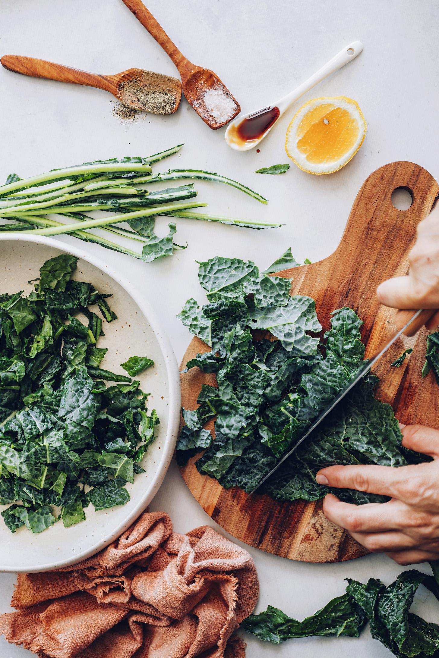 Slicing kale on a cutting board