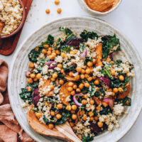 Bowl of hearty kale salad with chipotle pecan pesto