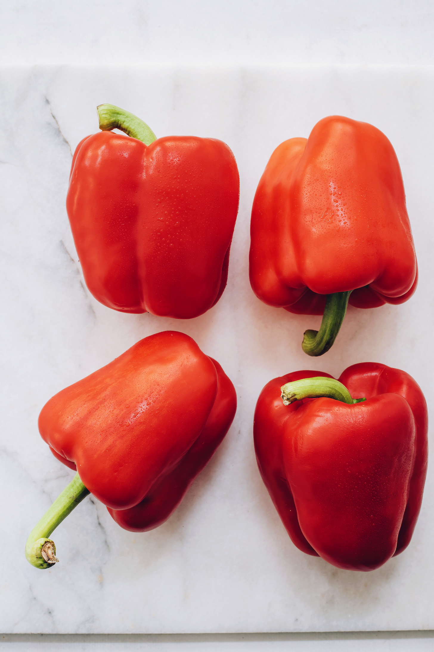 Four red bell peppers