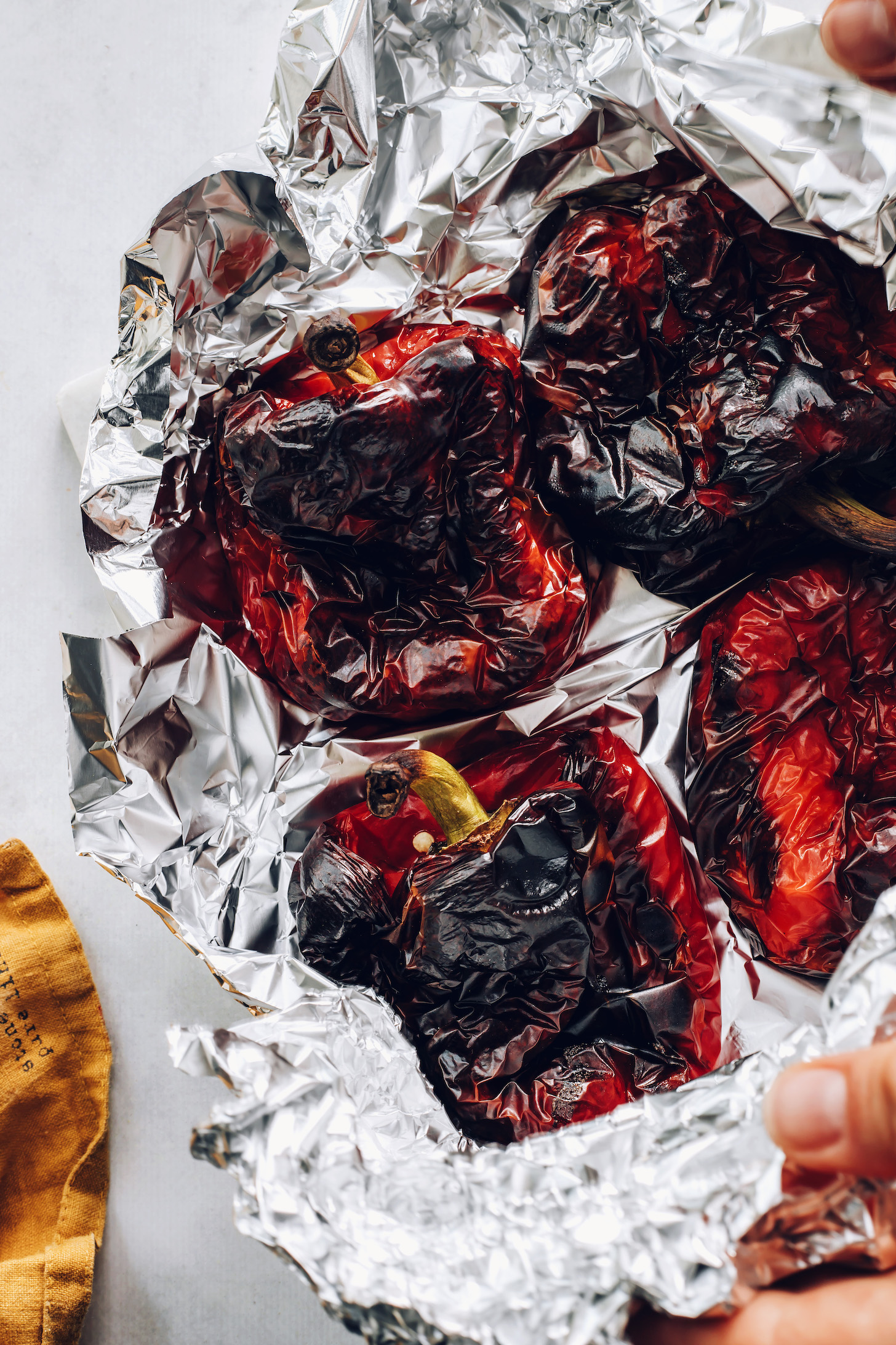 Roasted red bell peppers in foil