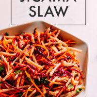 Bowl of vegan crunchy jicama slaw