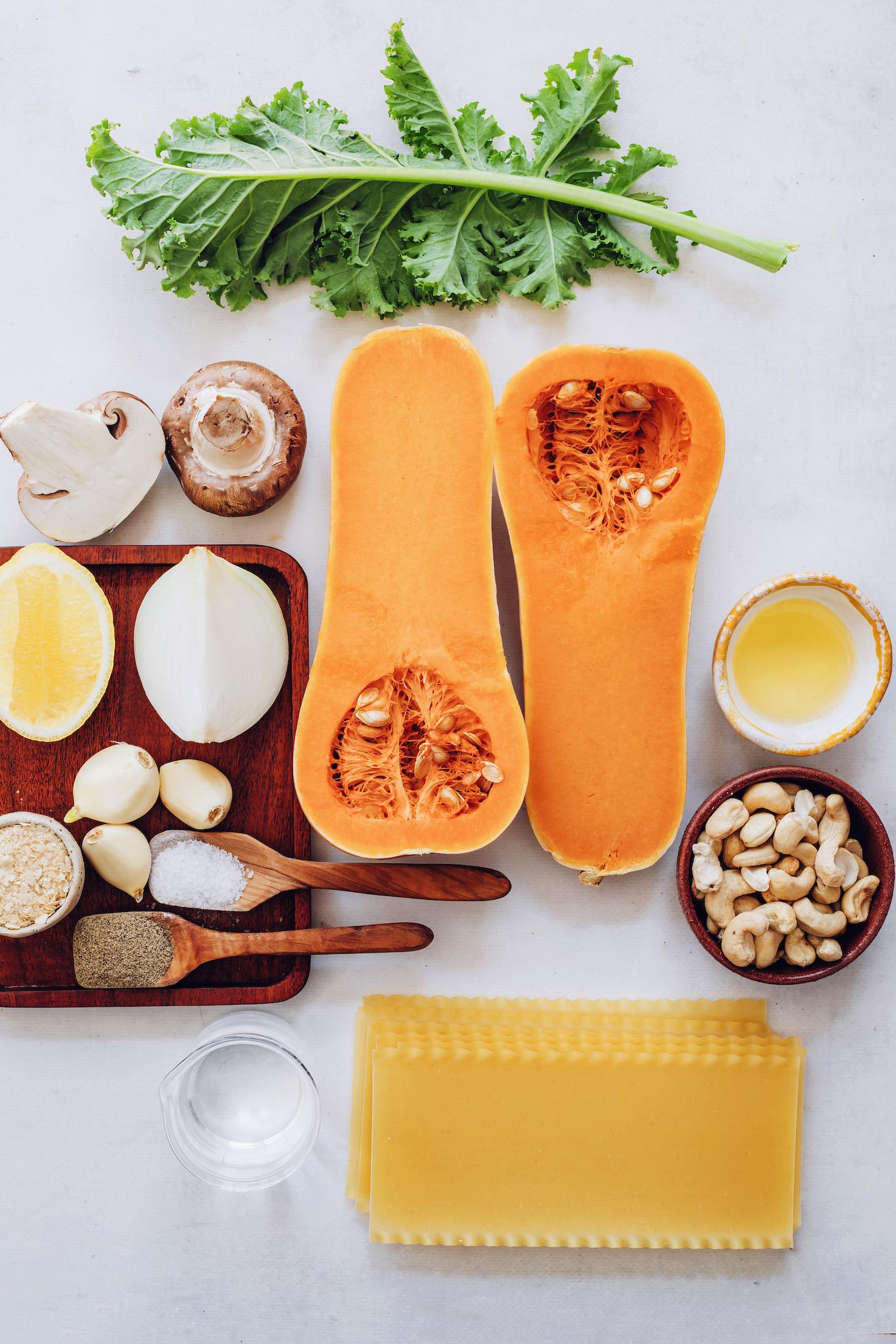Kale, mushrooms, butternut squash, garlic, salt, pepper, nutritional yeast, lemon, water, lasagna noodles, cashews, and olive oil