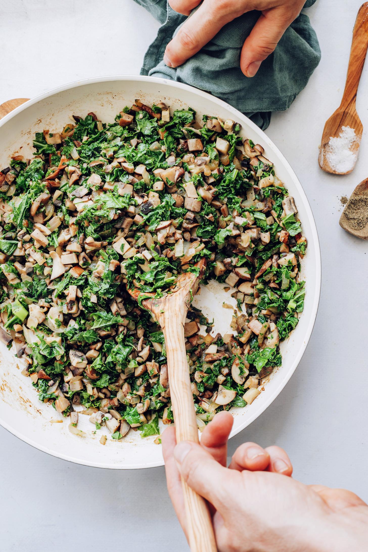 Skillet of sautéed kale, mushrooms, and onions