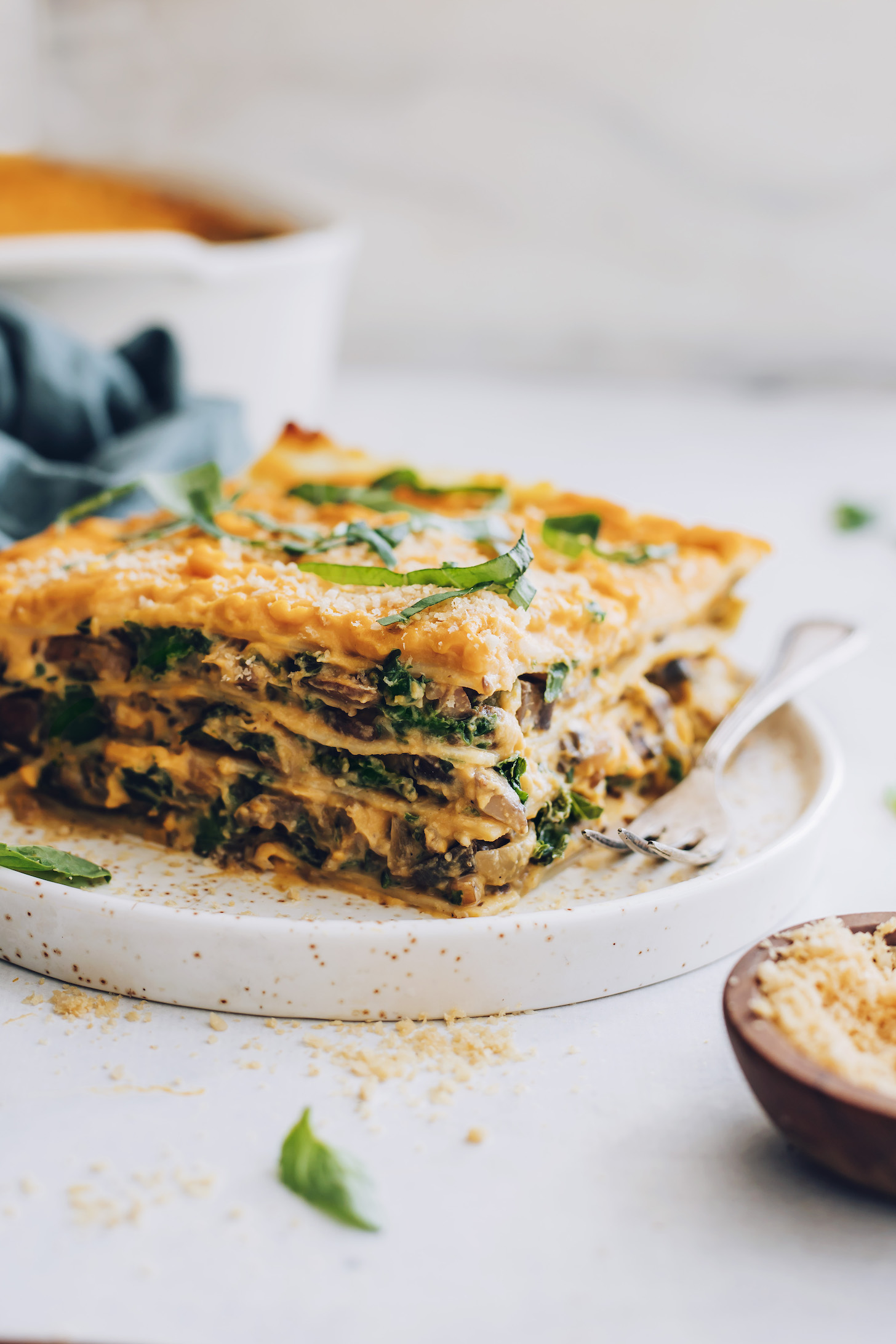 Fork and slice of butternut squash lasagna on a plate