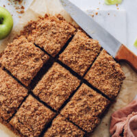 Overhead shot of slices of apple coffee cake with a crumb topping
