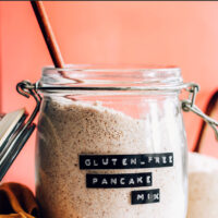 Jar of vegan and gluten-free pancake mix with a spoon in it