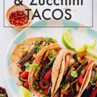 Plate of vegan and gluten-free bell pepper and zucchini tacos