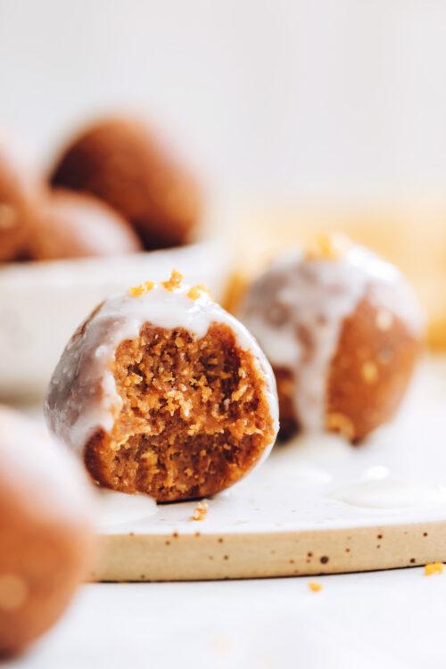 Close up shot of a pumpkin spice cake bite with coconut butter glaze