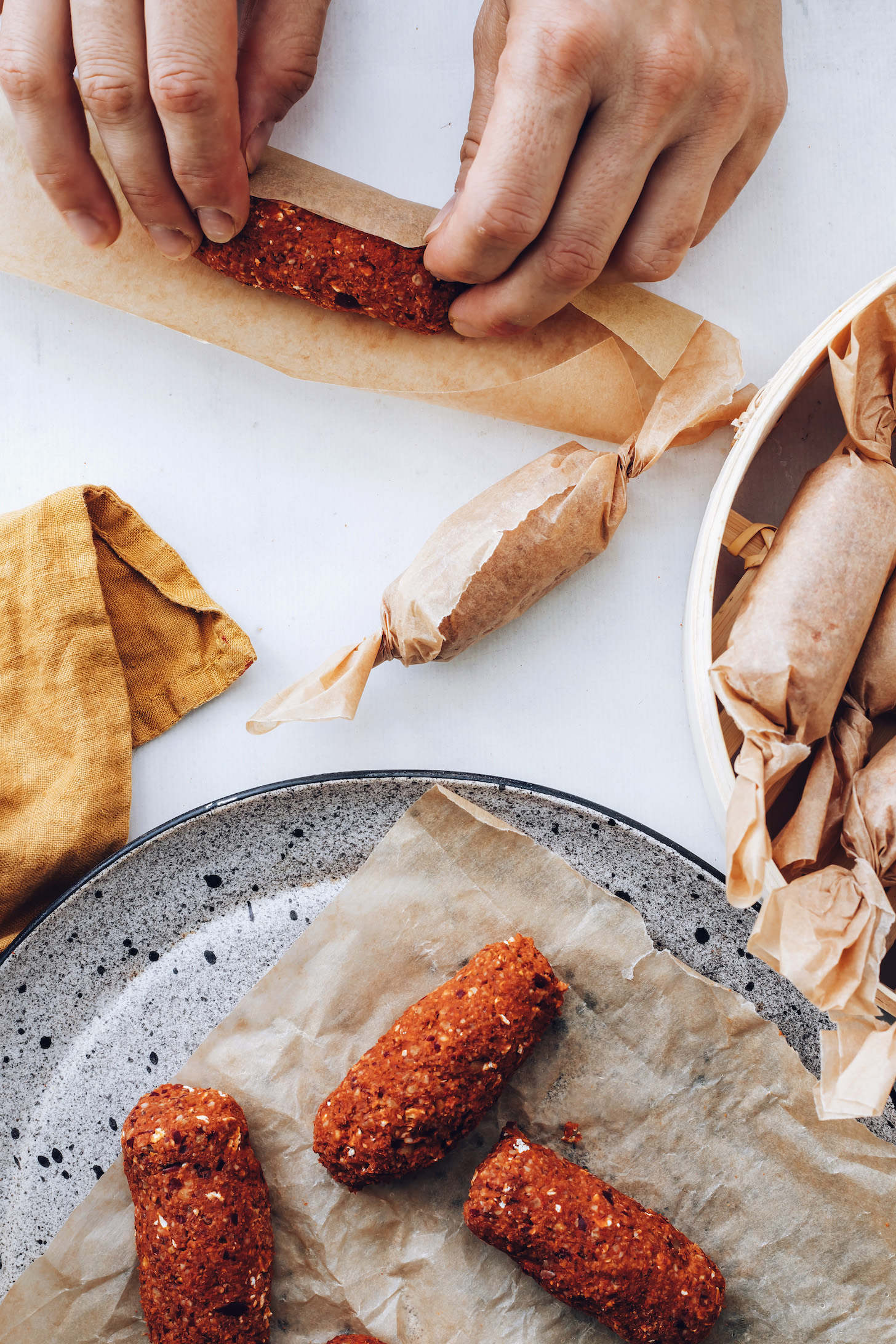 Wrapping chorizo links in parchment paper