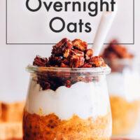 Jar of vegan and gluten-free pumpkin pie overnight oats with coconut yogurt and granola on top
