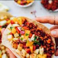 Hands holding a vegan chorizo breakfast taco